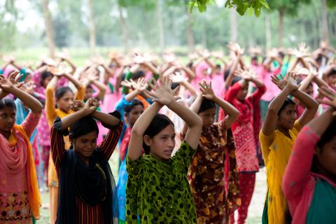 Girls participate in physical exercise as part of school activities at Chowrapara, Rangpur