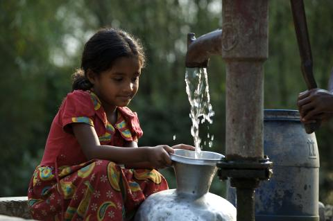 Girl collects water in pot at Sunamganj