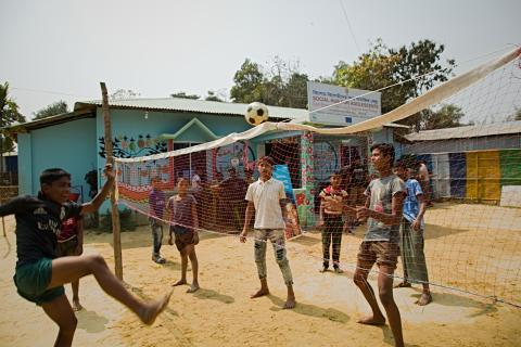 Youths are playing volleyball