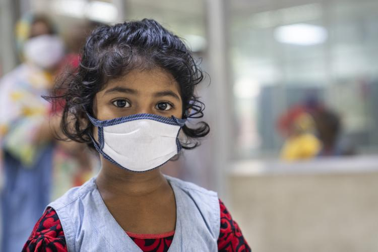 A Bangladesh girl child with a mask.