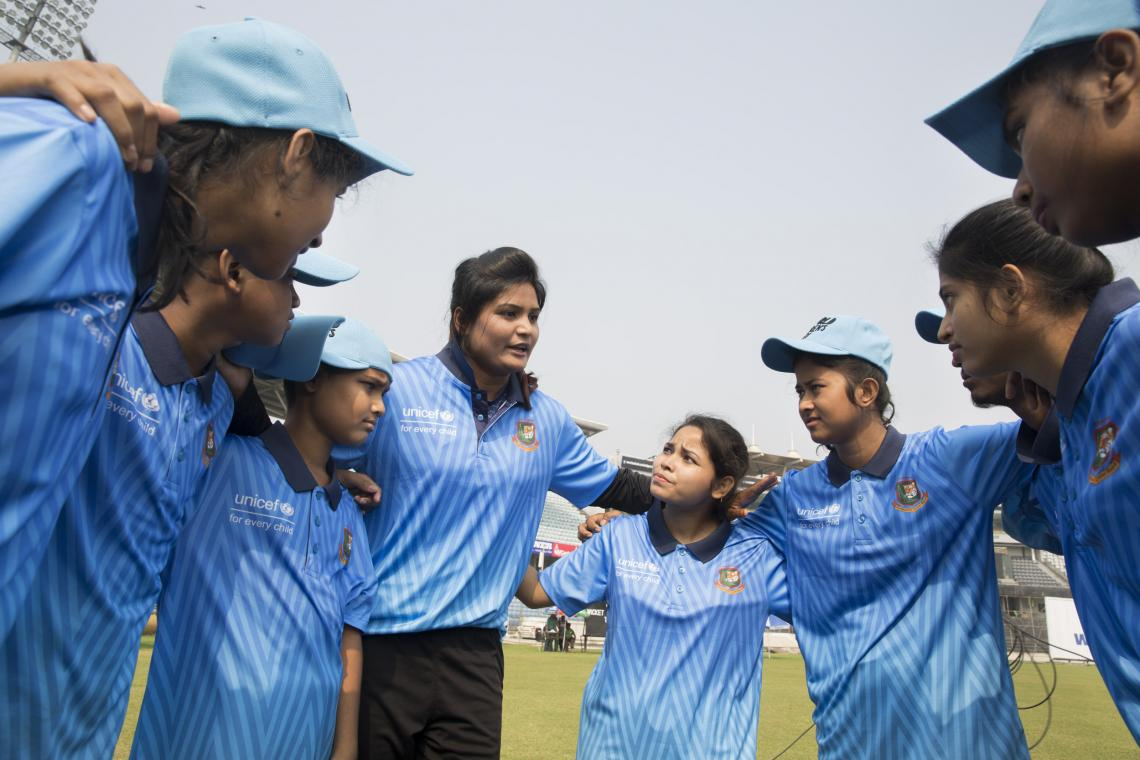Children's cricketers are practicing with the national women cricketers Suraiya AZmin