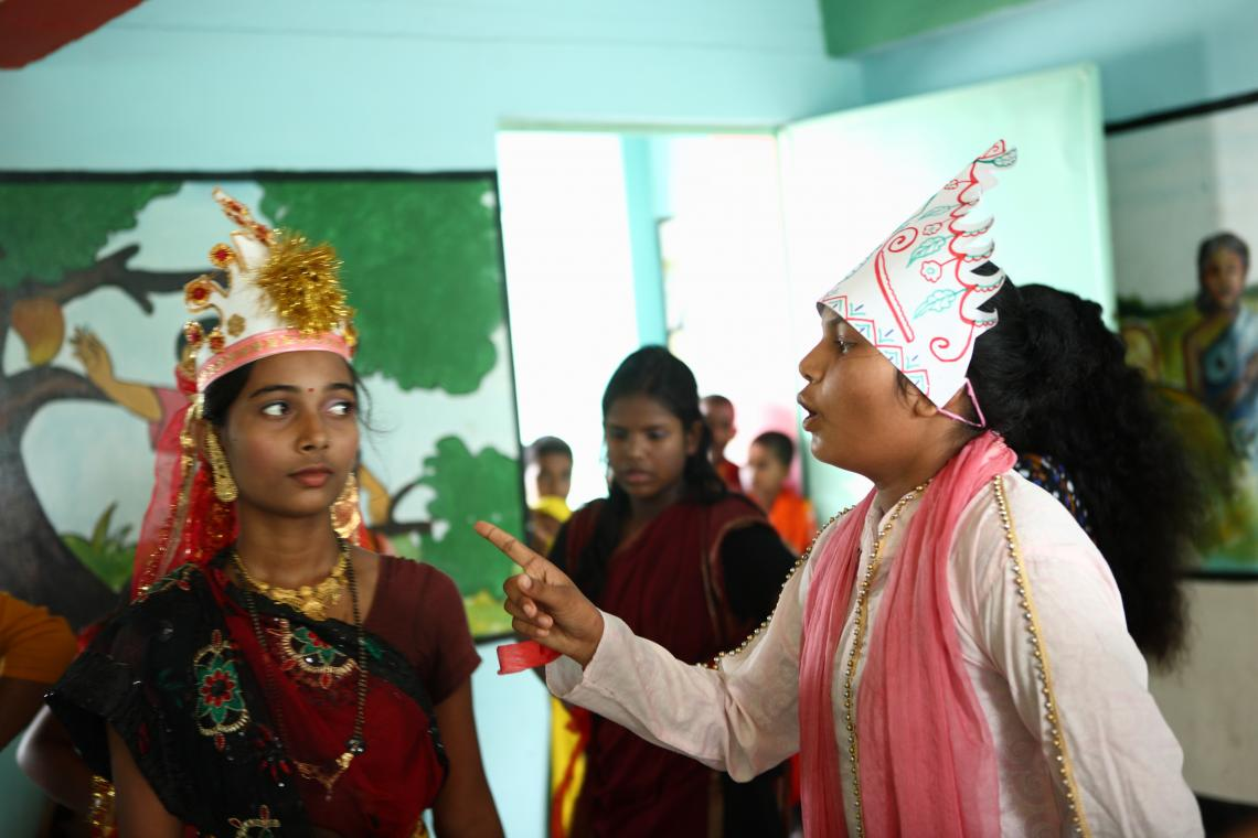 Children perform a drama to talk about the many risks surrounding child marriage.