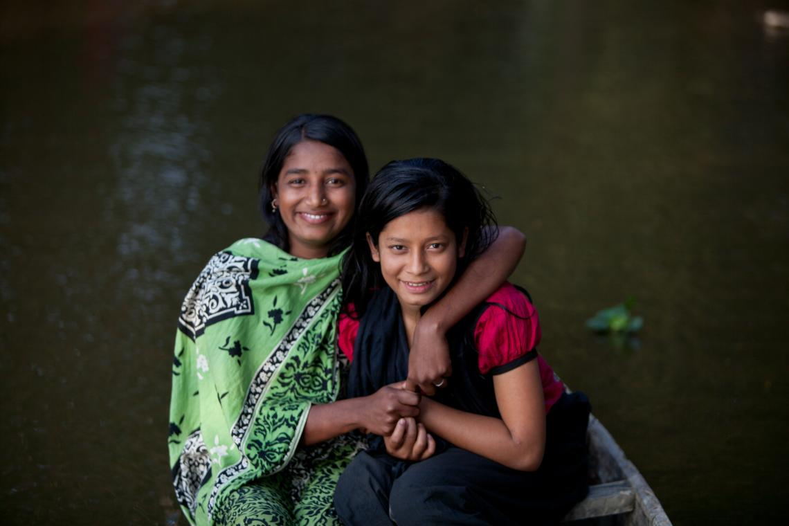 Child marriage survivor poses with a friend