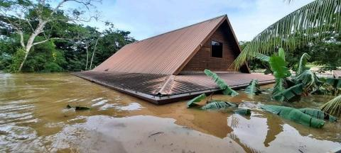 Belize: a house flooded by water up to the roof