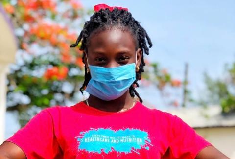 UNICEF Belize: close-up image of teenage girl wearing a mask.