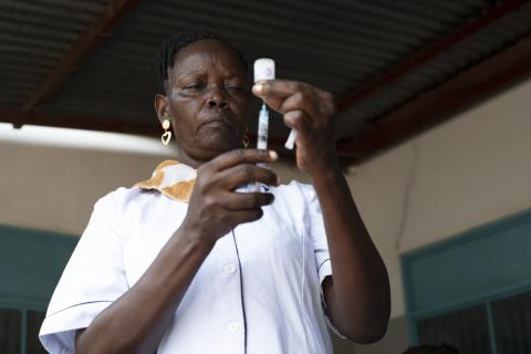 A nurse fills a syringe with a vaccine at in a health centre in Juba, South Sudan.