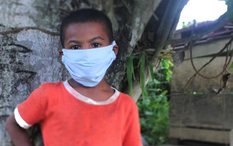UNICEF Belize: close-up image of a boy wearing a mask.
