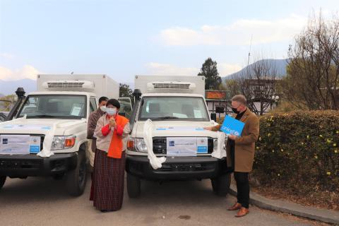 ADB and UNICEF officials handover two refrigerated vans to the Ministry of Health