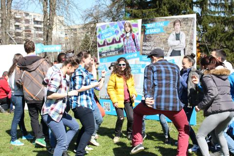 Adolescents and youth are dancing on the field in Sofia, Bulgaria, participating in UNICEF organized event.