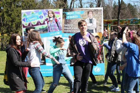 Young people dancing at a UNICEF event