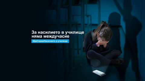 A girl sitting in a dark classroom with her face in her hands