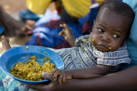 Claudine Hakimana ( 18 months) struggles to eat food prepared by Community Health Worker , Marie Chantal Niyomkuru ( 34) at her house where she helps vulnerable children to malnutrition, Wednesday 18 Sept 2019 in Nyanza Lac in Burundi.