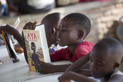 Children read books at a child friendly space for vulnerable children in the Buterere slum run by local UNICEF partner, Gyryuja, Monday 16 Sept 2019 in Bujumbura, Burundi.
