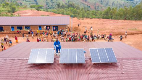 Solar panels are installed on the roof of a school