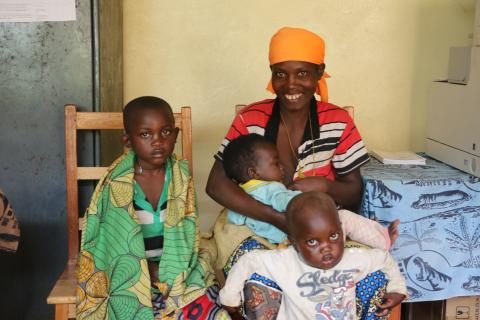 Niyindereye Emmanuelline is the mother of 3 children. She is breastfeeding while waiting for the doctor in the health facility.