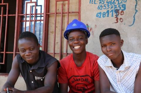Harouna, Saido and Pacifique in front of their welding training center.