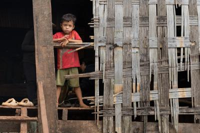 A boy in his home in Kak Village, Kak commune, Borkeo Disctrict, Ratanakiri