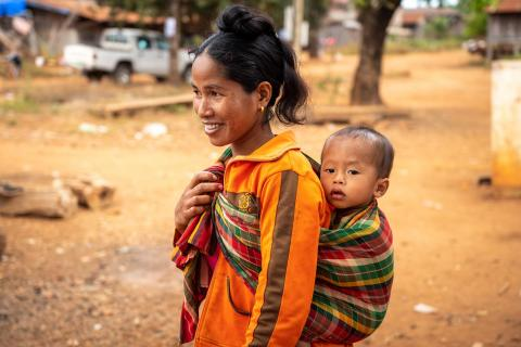 Sev Tet and her child Teang after attending a health and nutrition screening.