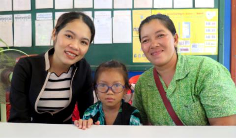 Pheap Sort (left), a preschool teacher for children with disabilities, and Sambat Kong (middle), a six-year-old girl who dreams to be a teacher like Pheap to support her mother, Mel (right), in the future. Prasat Bakorng Primary School, Siem Reap