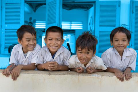 Children smile at the camera at Watanak Chhoung Leap Primary School in Sa'ang District, Kandal province on July 2, 2018.
