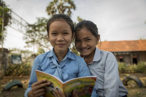 Girls reading Growth and Change book
