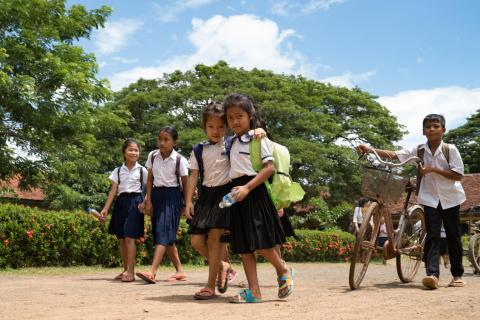 Groups of students leave school at Kampong Thmar Primary School, Kang Sao village, Santok district, Kampong Thom commune, Kampong Thom province on July 5, 2018.