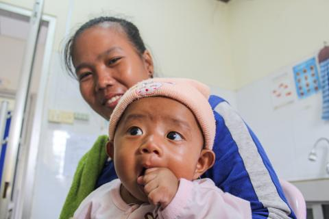 Mother, Sreymom, with her three-month-old baby at Dar Health Clinic. Chitborie district, Kratie Province, August 2019.