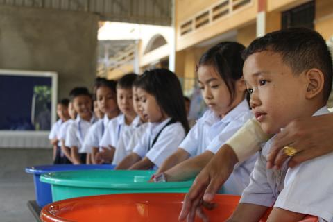 Children at Tuol Thmor primary school undertake supervised handwashing activities.