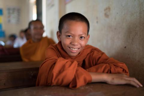 A monk sits in class at Svay Kal Primary School
