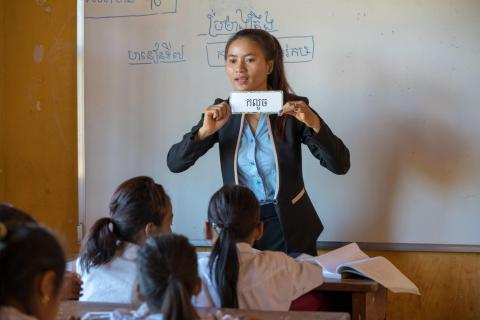 Chea Lach uses flash cards to teach in two languages, Kreung and Khmer