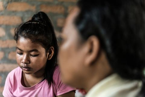 Social Worker Phon Chanthorn (47) consults a family in Kandal province, Cambodia. All children have the right to be protected. Yet in Cambodia, the situation is dire for many. One in two children have experienced severe beating, one in four children have experienced emotional abuse, and 1 in 20 girls and boys have been sexually assaulted.