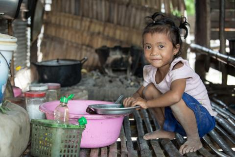 Phan Bopha, 4 years old, always works with her smiley face