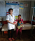 Health staff conduct a nutritional screening activity (MUAC) at Pril village, Borkham commune, Borkeo district, Ratanakiri province to detect severe acute malnutrition cases among vulnerable children