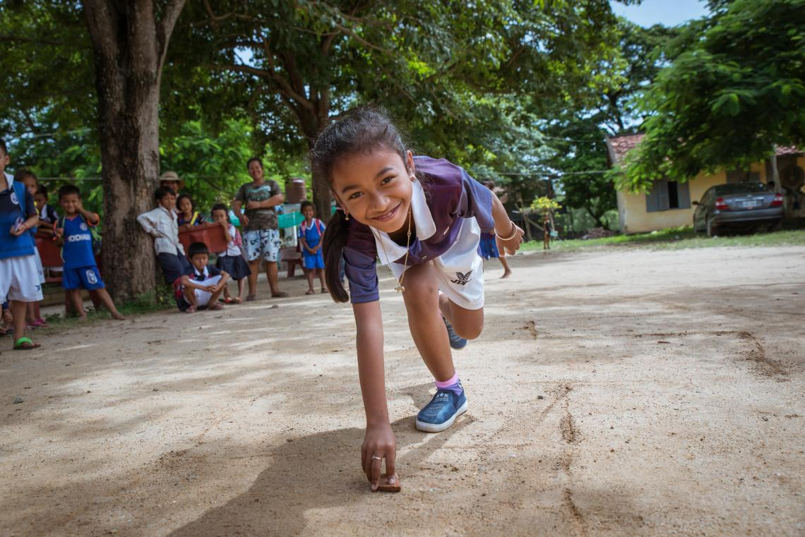 Students are playing hopscotch at the school playground. Peam Ror School. Peam Koh village. Peam Ror District. Svay Rieng Province. Cambodia, 2018