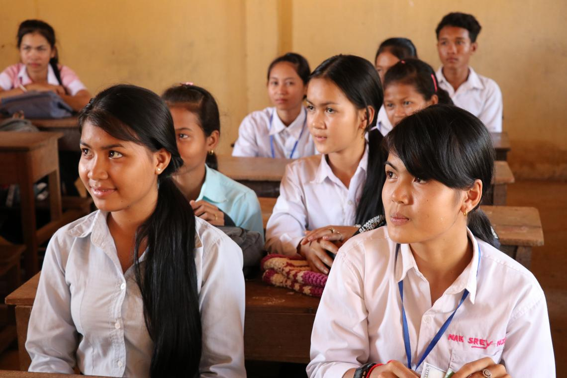 Grade 9 students from Thmor Sor secondary school listen to their teacher