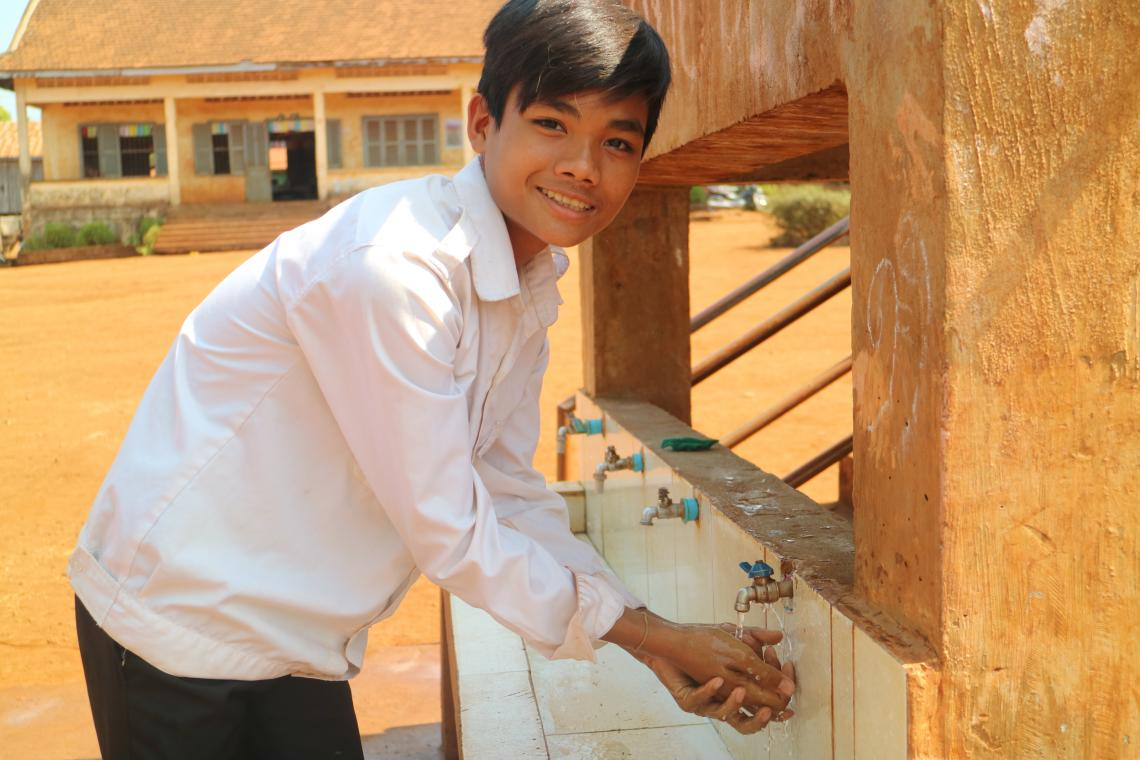 Chromourn Sany (14), is using the latrine built at school by Plan International under the sanitation programme cooperated with UNICEF Cambodia.