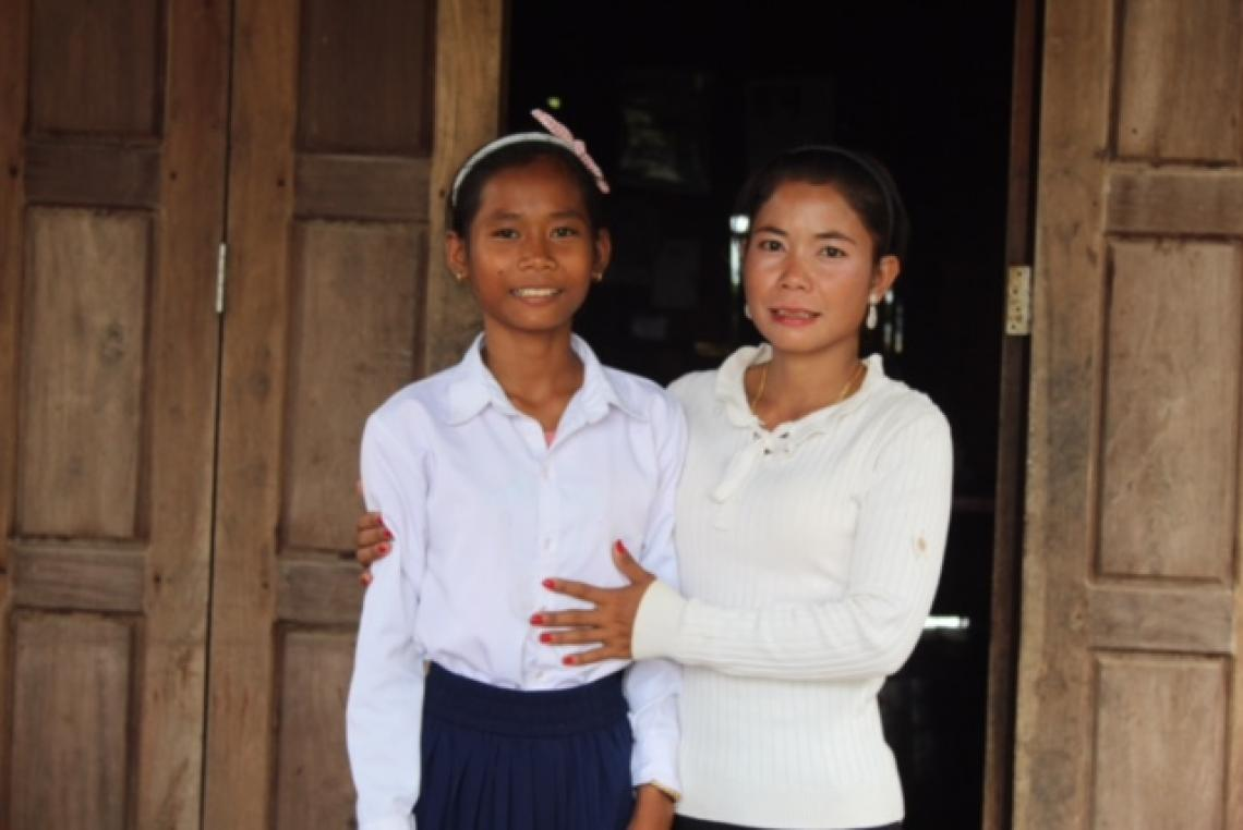 14-year-old student with her mother, whom she has recently convinced to purchase a toilet for their family home. Sambo district. Kratie. August 2019.
