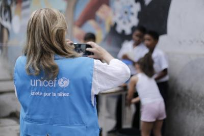 UNICEF employee capturing with a camera
