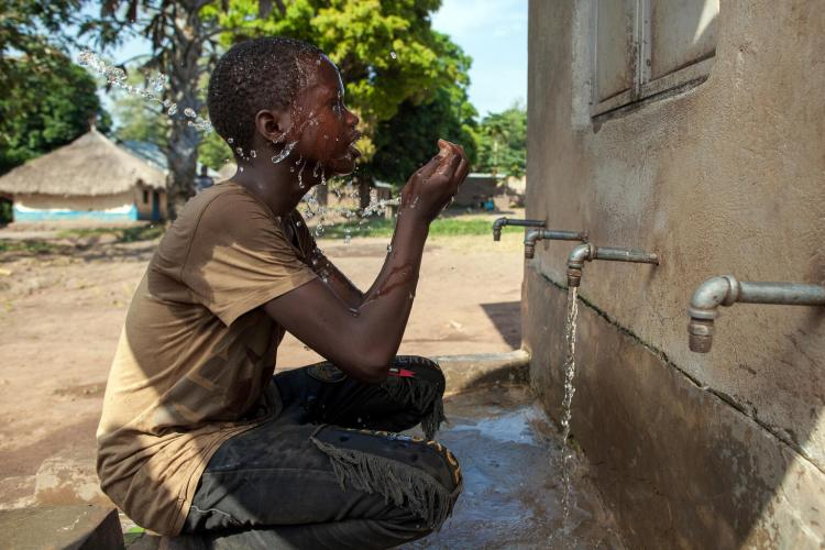 On the 26th November 2020, thirteen year old Bakindo Jackson rinses his face at a water facility in Yambio, South Sudan.