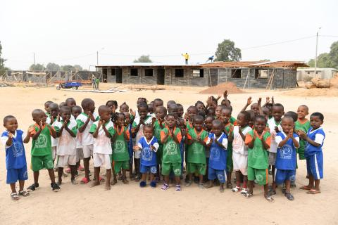 Primary schoolchildren are happy with the construction of a new school made out of plastic bricks in Odienné, in the Northwest of Côte d'Ivoire.