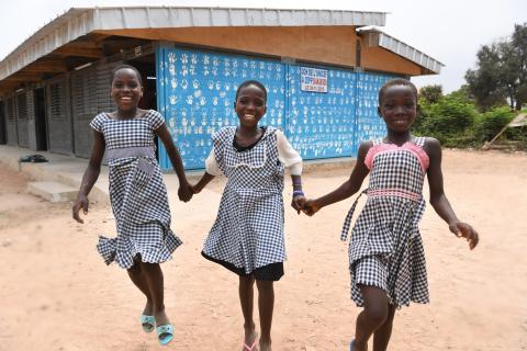 Primary school girls play in front of their school built from plastic bricks in the village of Toumoudi-Sakassou in Côte d'Ivoire