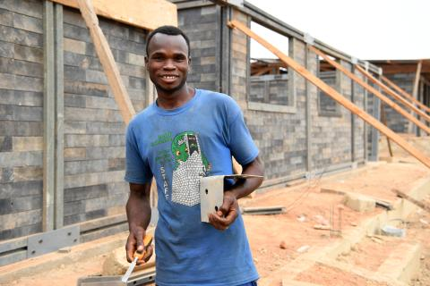 Diarrassouba Mory, 23-year-old, is helping to build a school made of recycled plastic bricks in Odienné, in the north-west of Côte d'Ivoire.