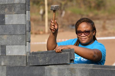 Sylviane Irène Zika, a UNICEF engineer, at the construction site of school made out of plastic bricks in Gouékolo, in the west of Côte d'Ivoire.