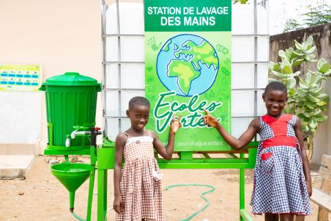 Children in front of the handwashing facility installed in their school as part of the Green Schools project.