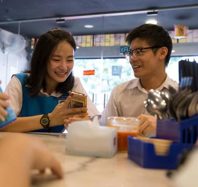 Angeline Chong (centre), a student at the Sekolah Menengah Kebangsaan Subang Jaya school, chats with friends in Malaysia