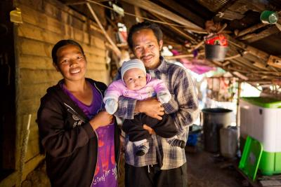 a mother and father with their baby in Chiang Mai, Thailand