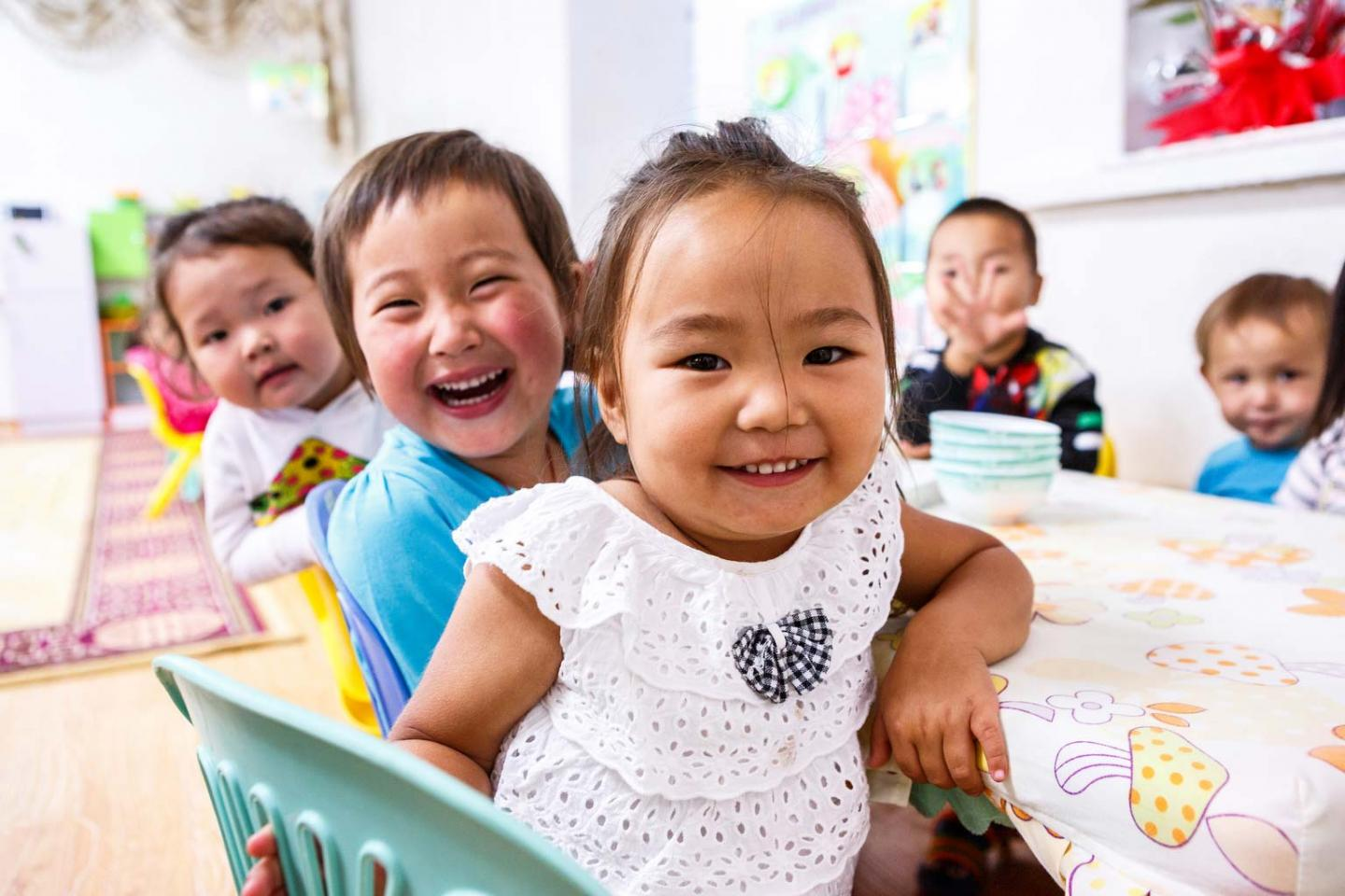 Kids smiling after their lunch in a kindergarten which is supported by UNICEF Mongolia's nutrition programme in Nalaikh, district Ulaanbaatar