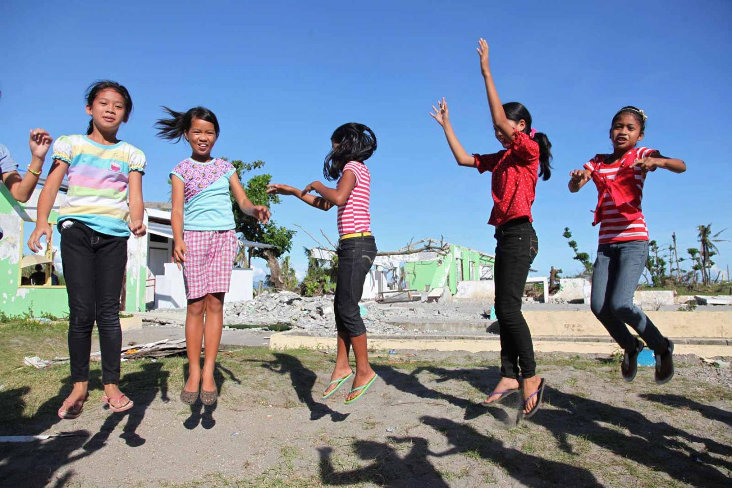 girls jumping together in the Philippines