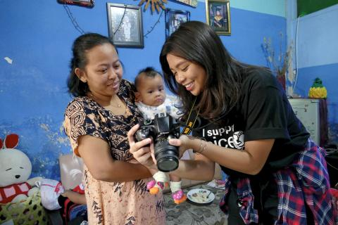 A workshop participant showing her photo to a subject on her camera