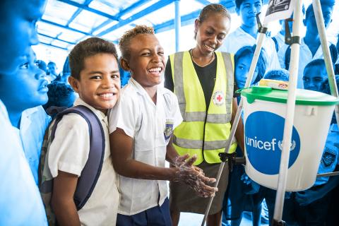 Grade 3 student of White River School in Honiara, Patty Patrick, 10, washing his hands next to a Red Cross staff member during a workshop organised by UNICEF with their partners from the Red Cross. During the workshop Red Cross workers showed children how to properly use hygiene items